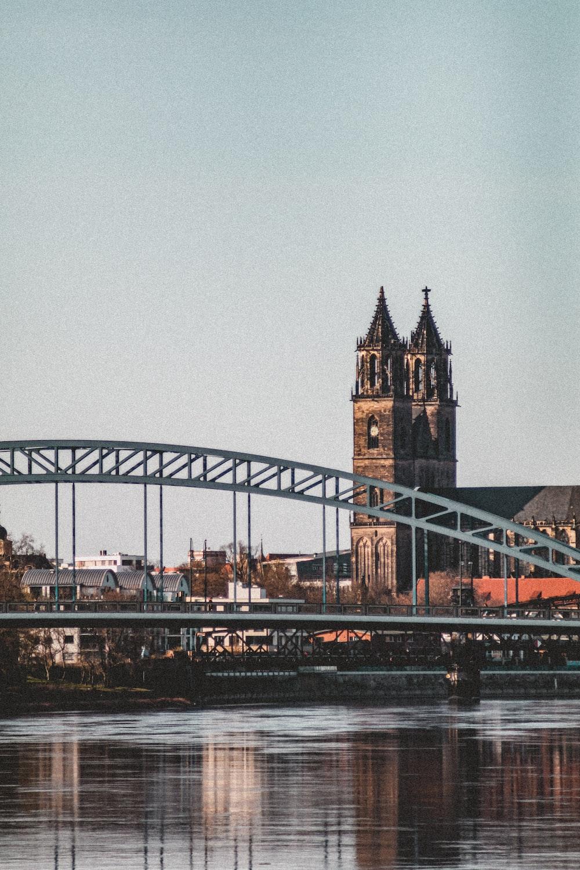 brown and gray bridge under gray sky