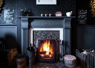 black fireplace with brown wooden frame
