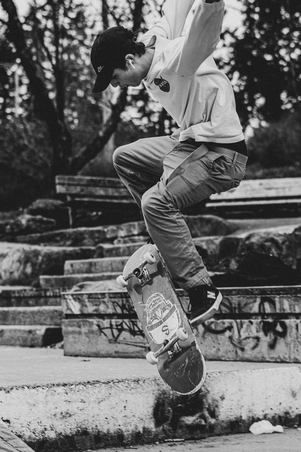 man in white hoodie and pants playing skateboard