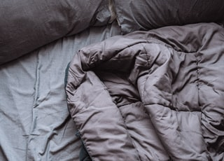 blue bed linen on bed