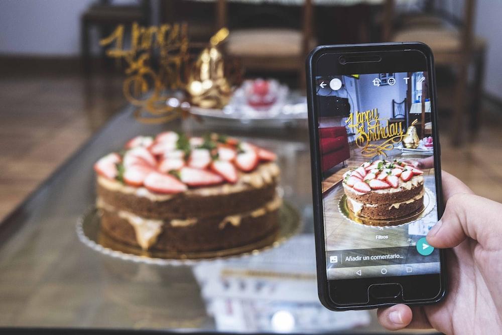 black samsung android smartphone displaying chocolate cake