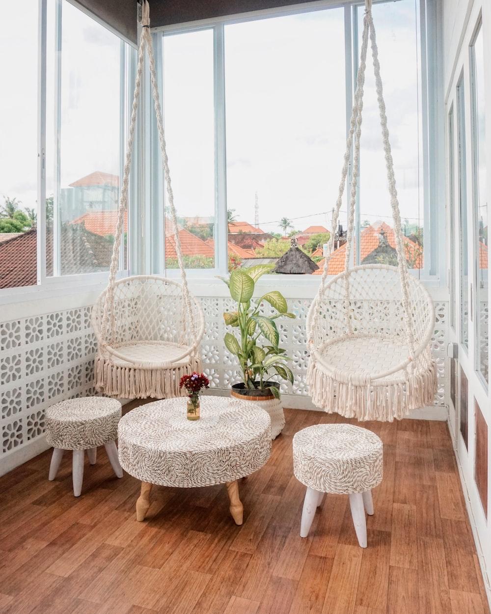 white wicker chair near white table