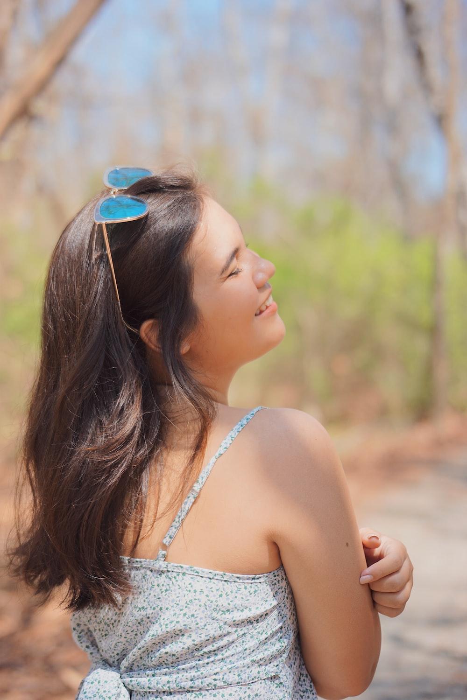woman in white tank top wearing blue sunglasses