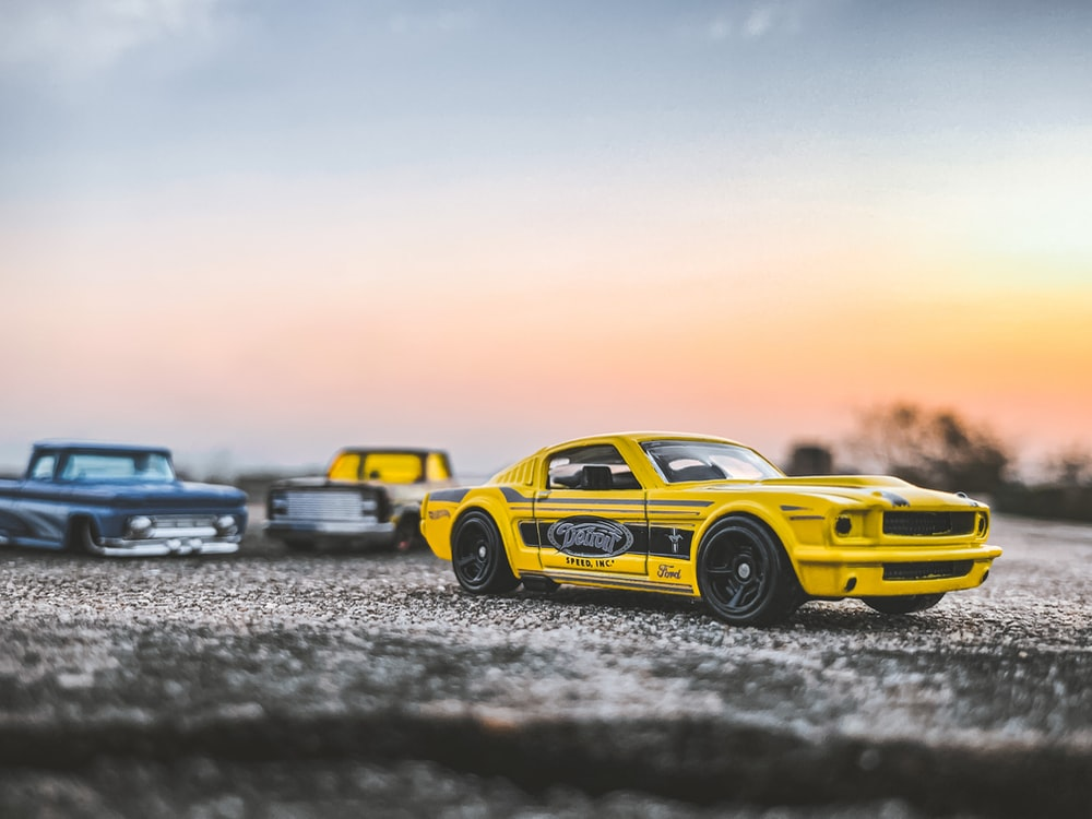 yellow and black chevrolet camaro on gray sand during daytime