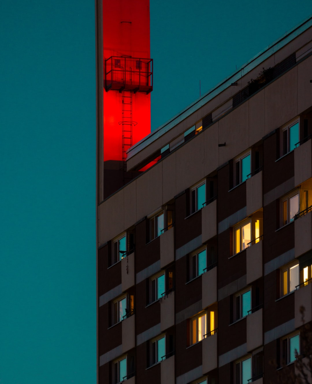 Red lit chimney on residential building