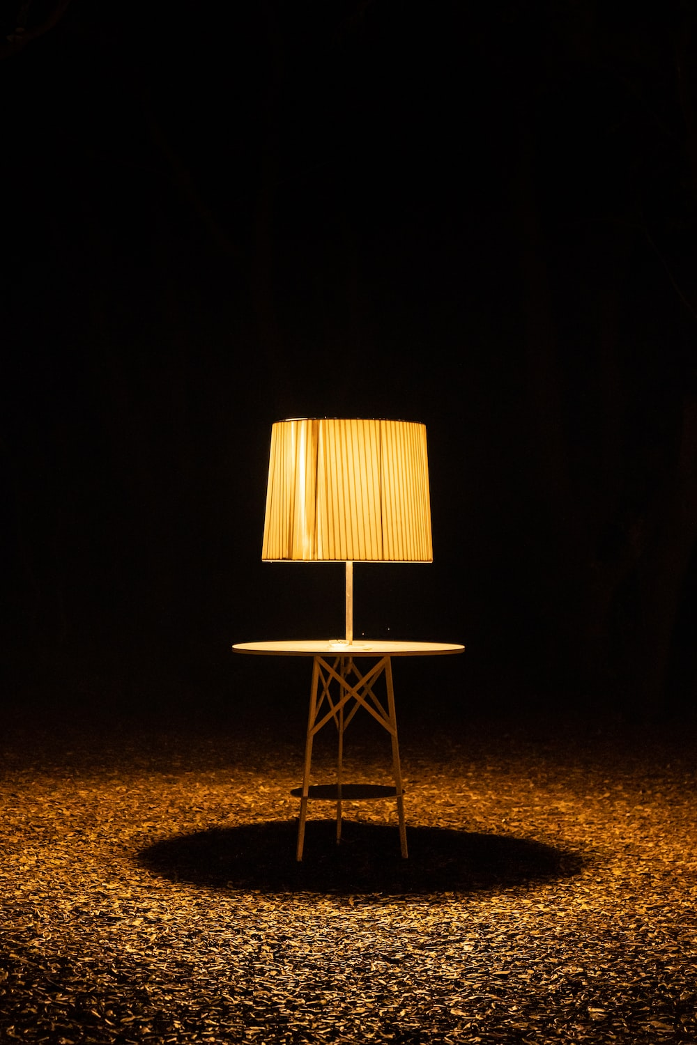brown wooden chair with brown lampshade