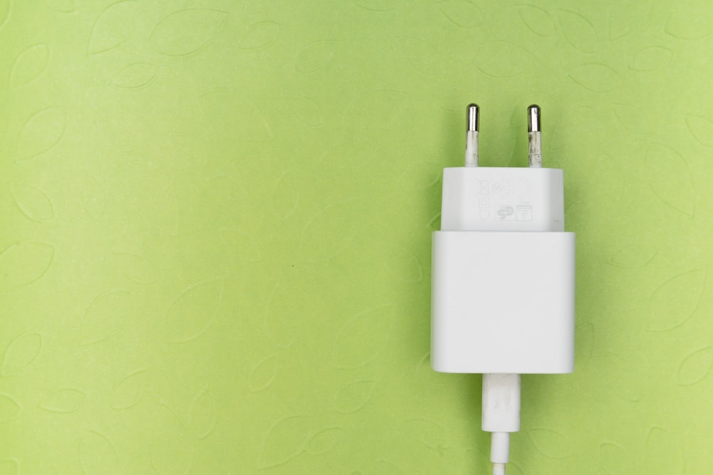 white adapter on green wall