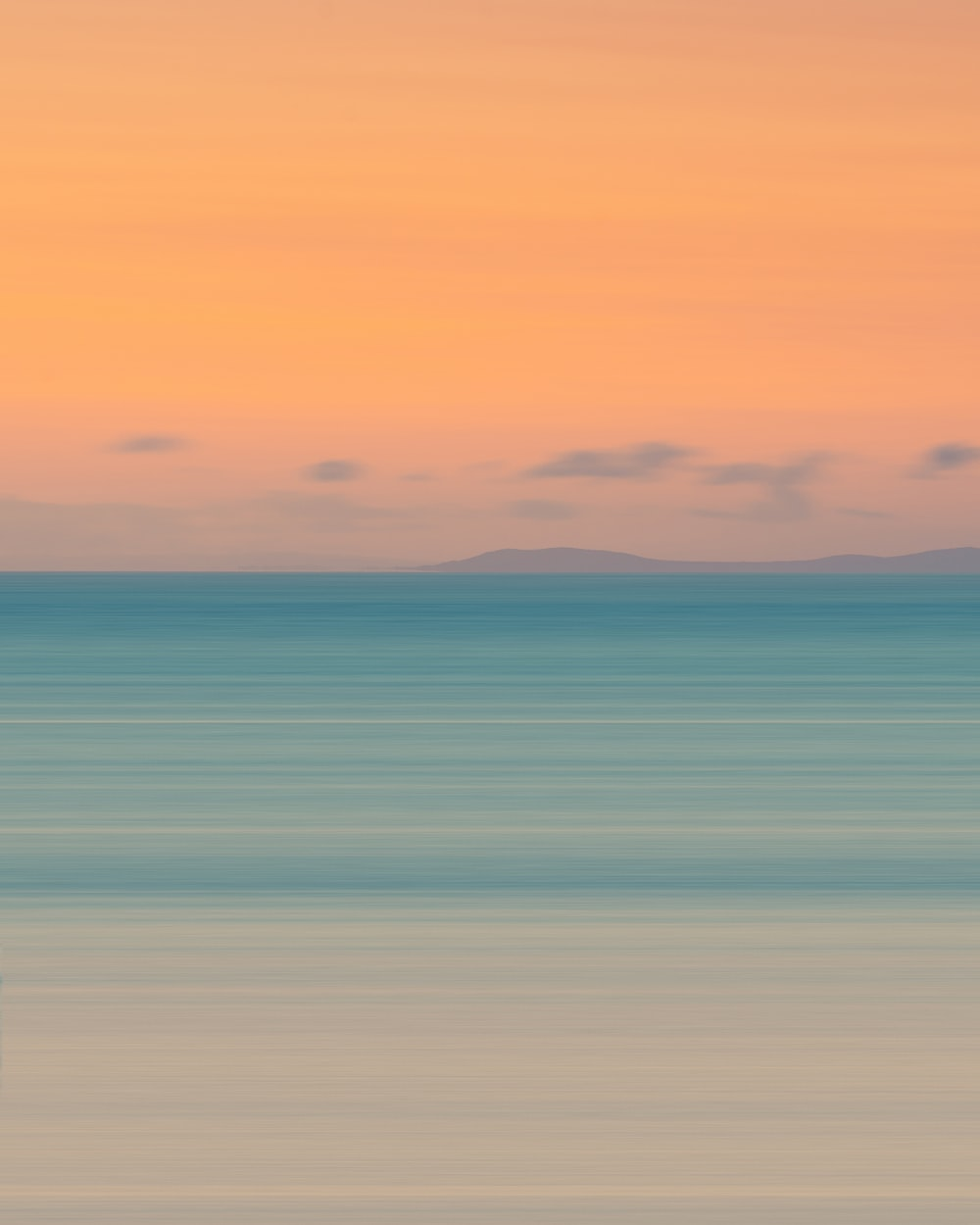 blue and orange sky over the sea