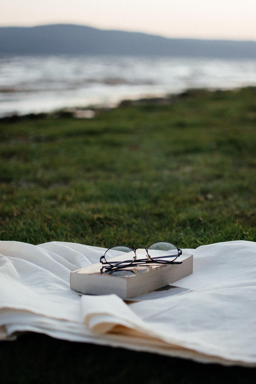 black framed eyeglasses on white textile