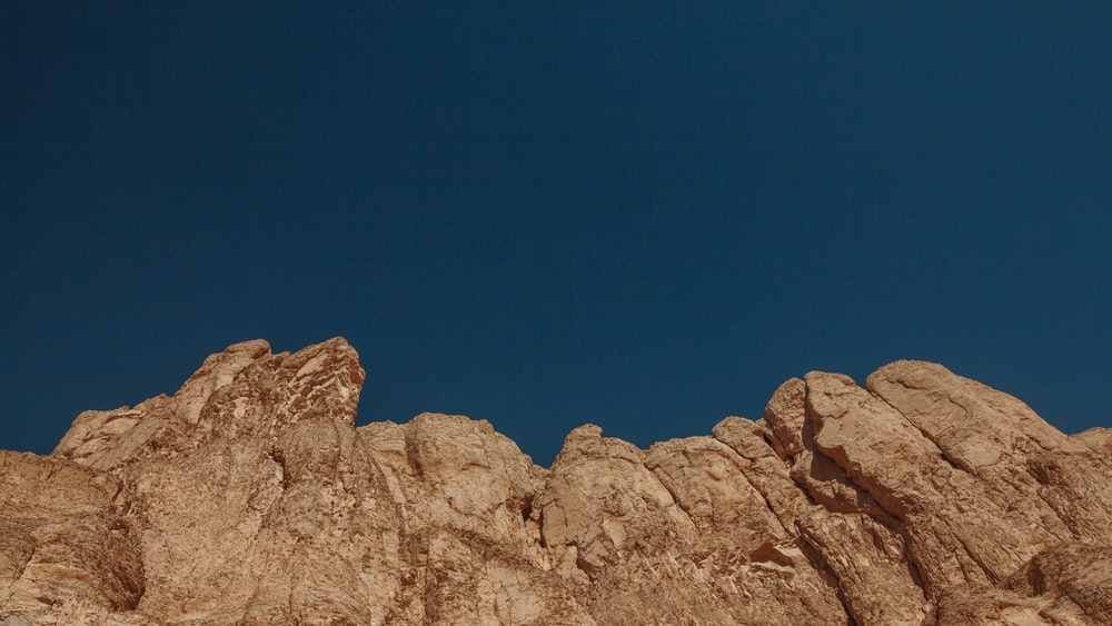 brown rock formation under blue sky during daytime