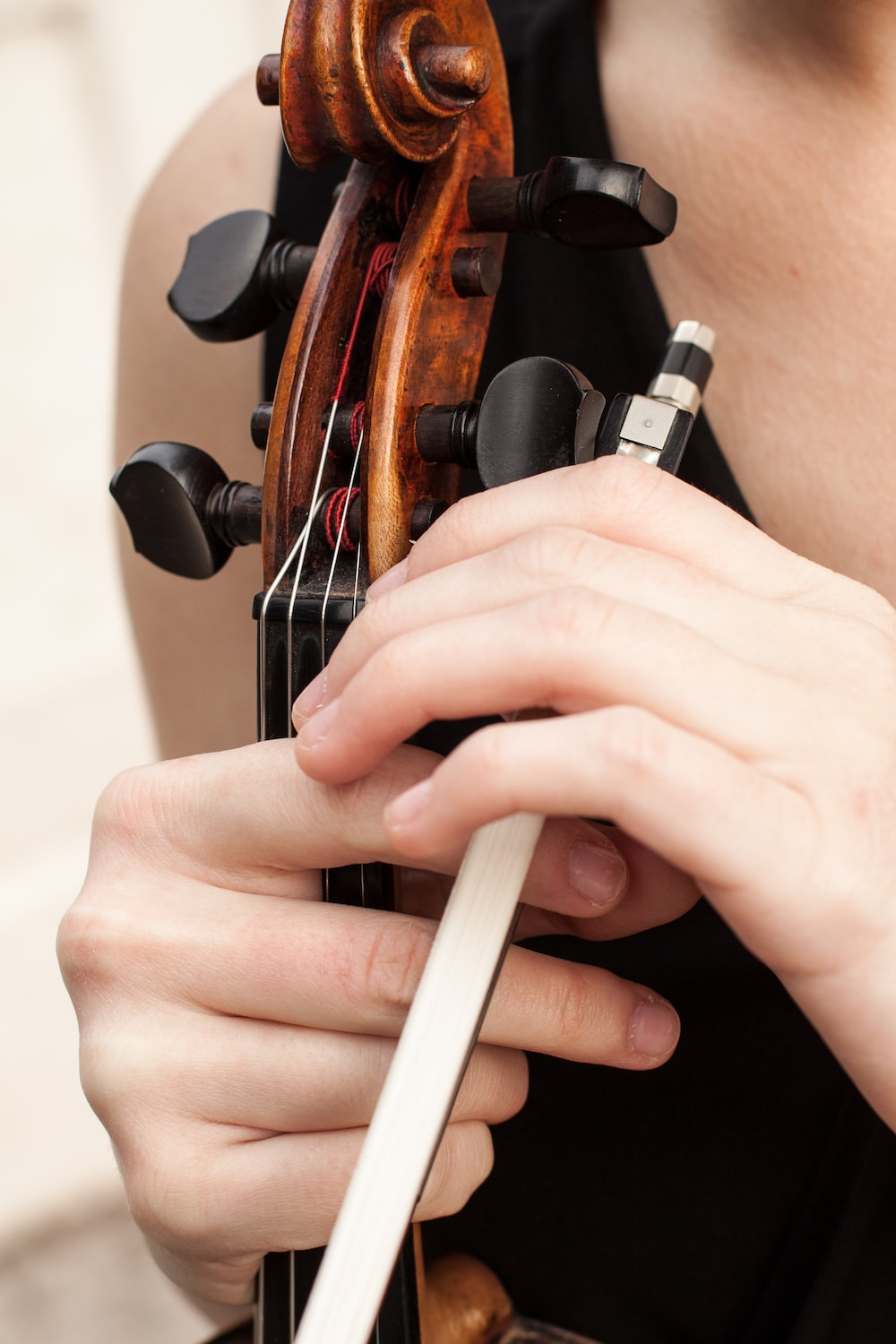 person playing violin in close up photography