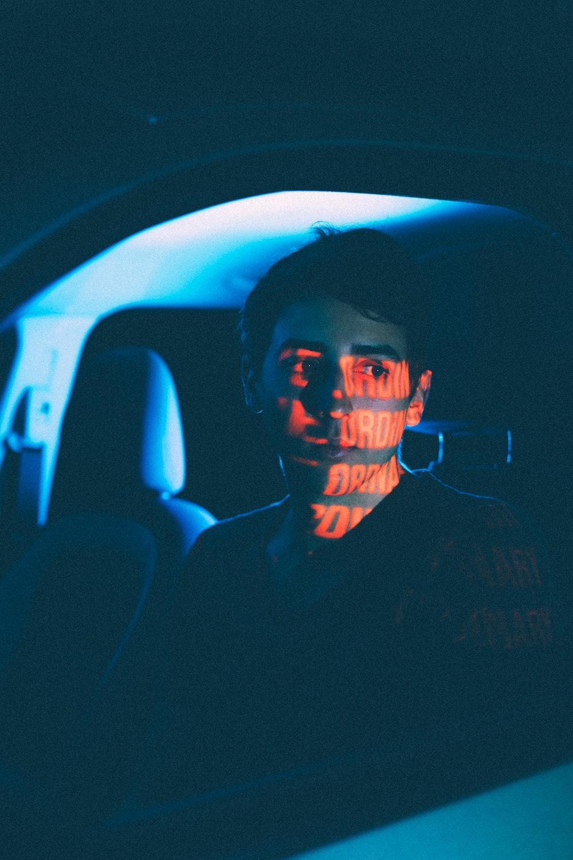 man in black shirt inside car