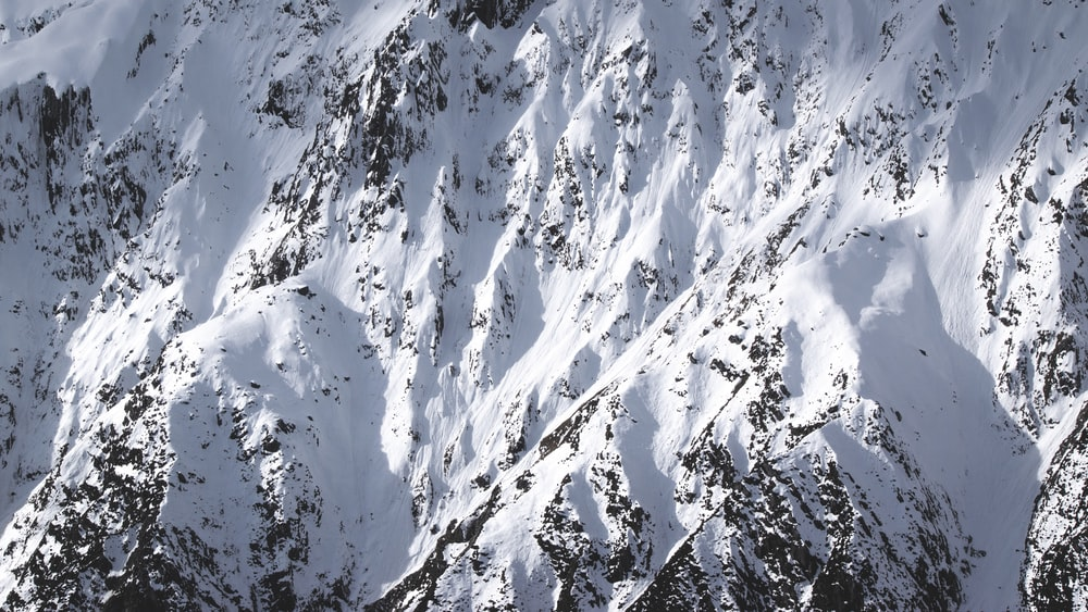 white and black snow covered mountain