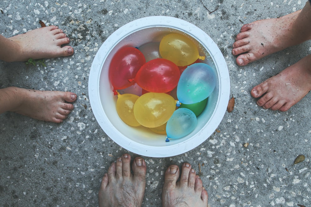yellow red blue and green balloons on white round plate