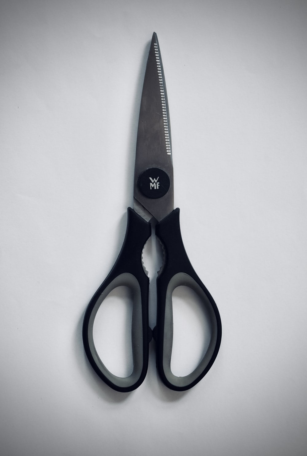 blue and red handled scissors