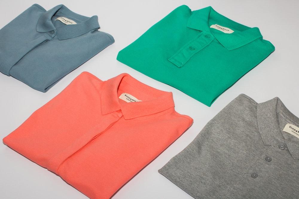 green crew neck shirt and gray crew neck shirt