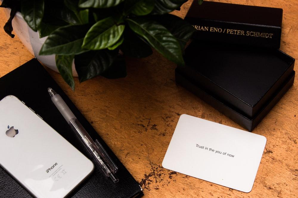 white printer paper beside black laptop computer