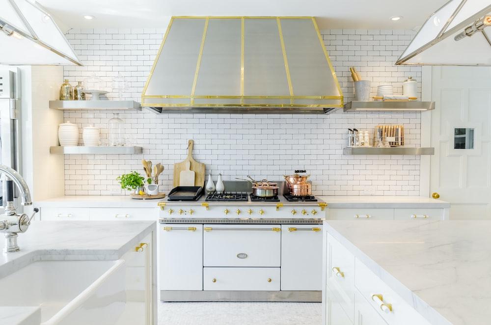 white kitchen cabinet near white stove oven