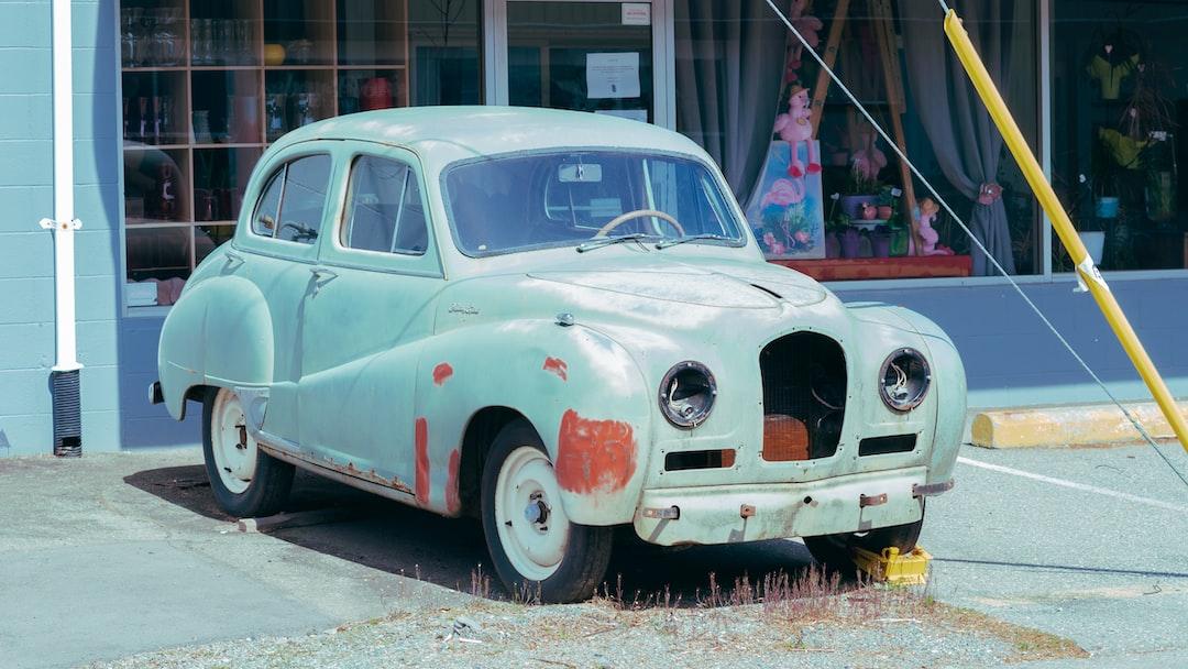 Rusting teal old car