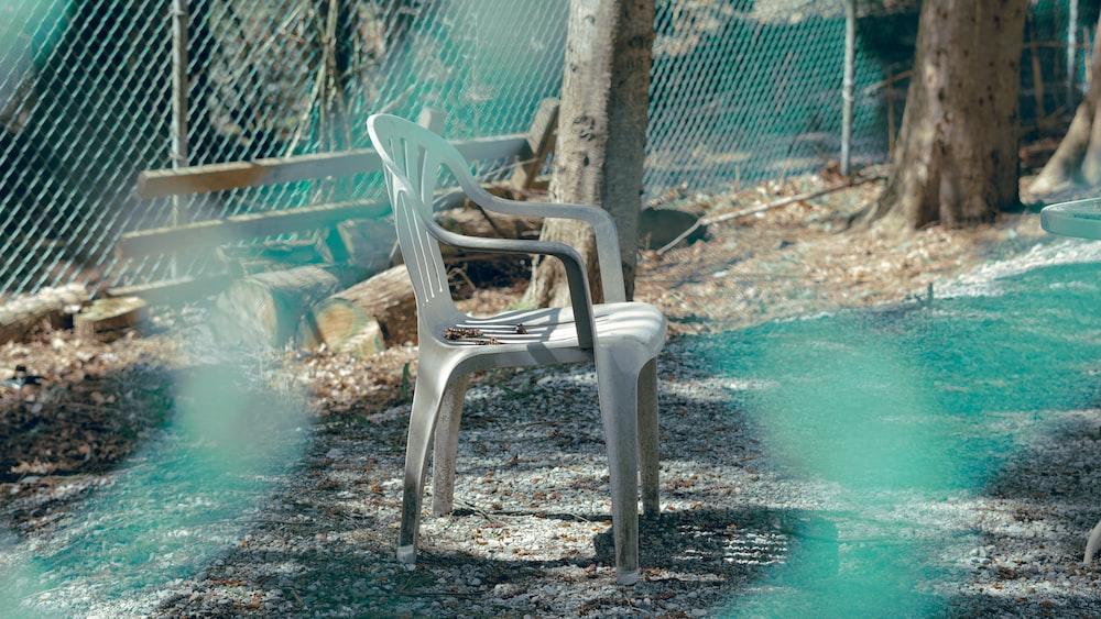 white plastic armchair on swimming pool