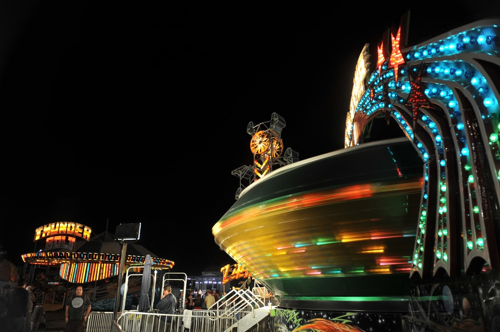 people riding on carousel during night time