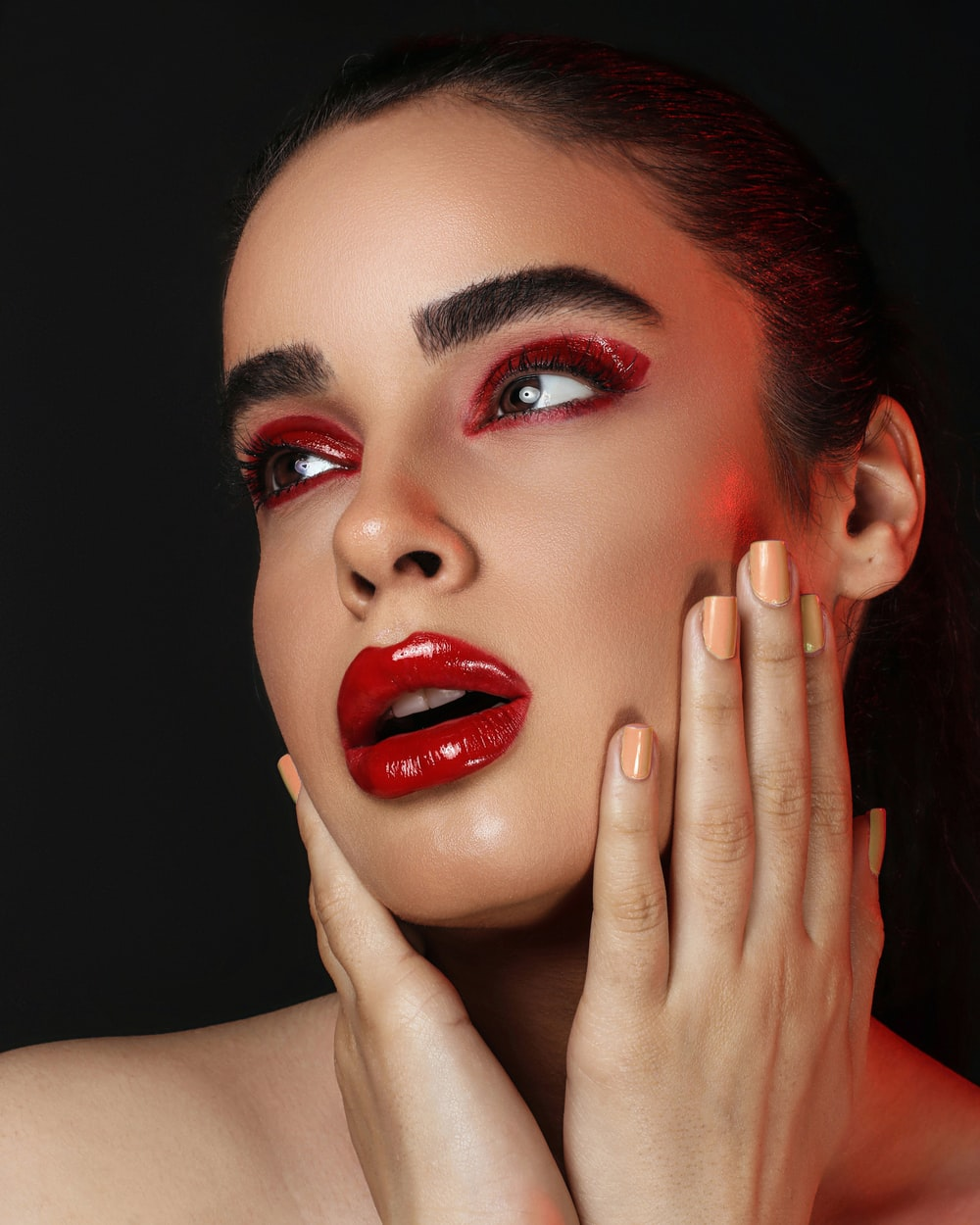 woman with red lipstick and red lipstick