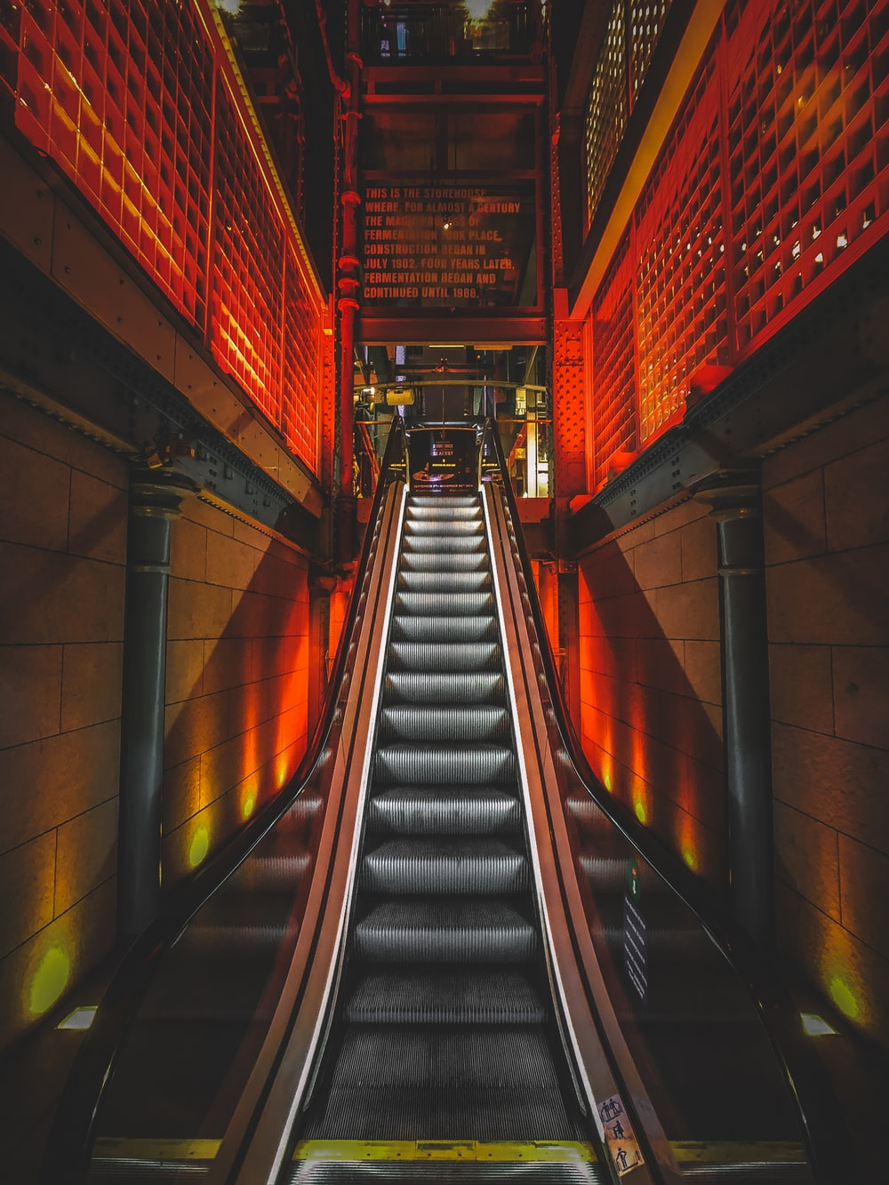 black and red escalator in a tunnel