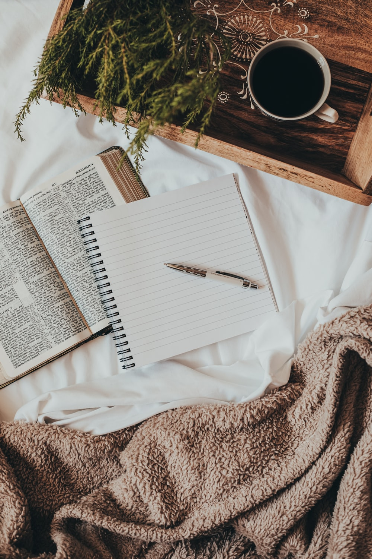 white notebook on white textile