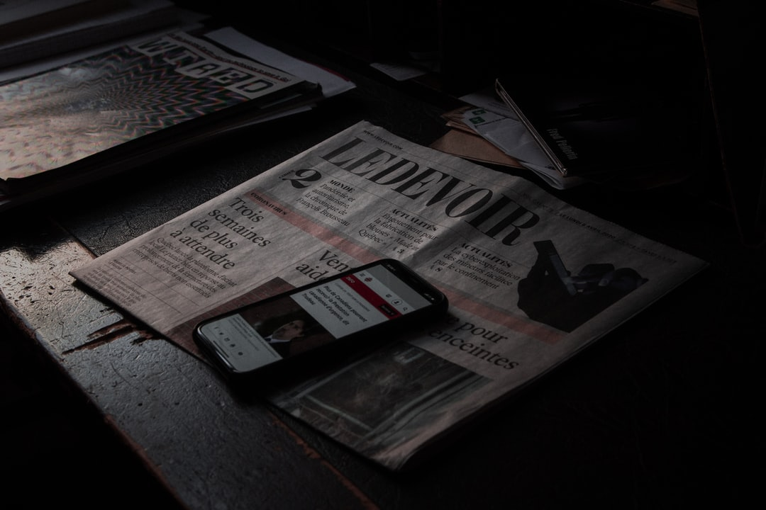 Reading the News But Make It Moody. Thanks For Having That Amazing Font Le Devoir. - unsplash