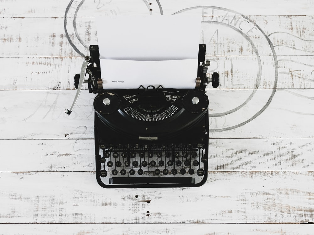 black and white typewriter on white paper
