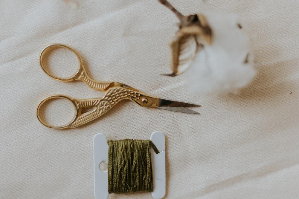 silver scissors beside white and gold scissors