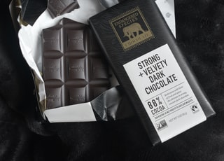 white and brown labeled chocolate bar