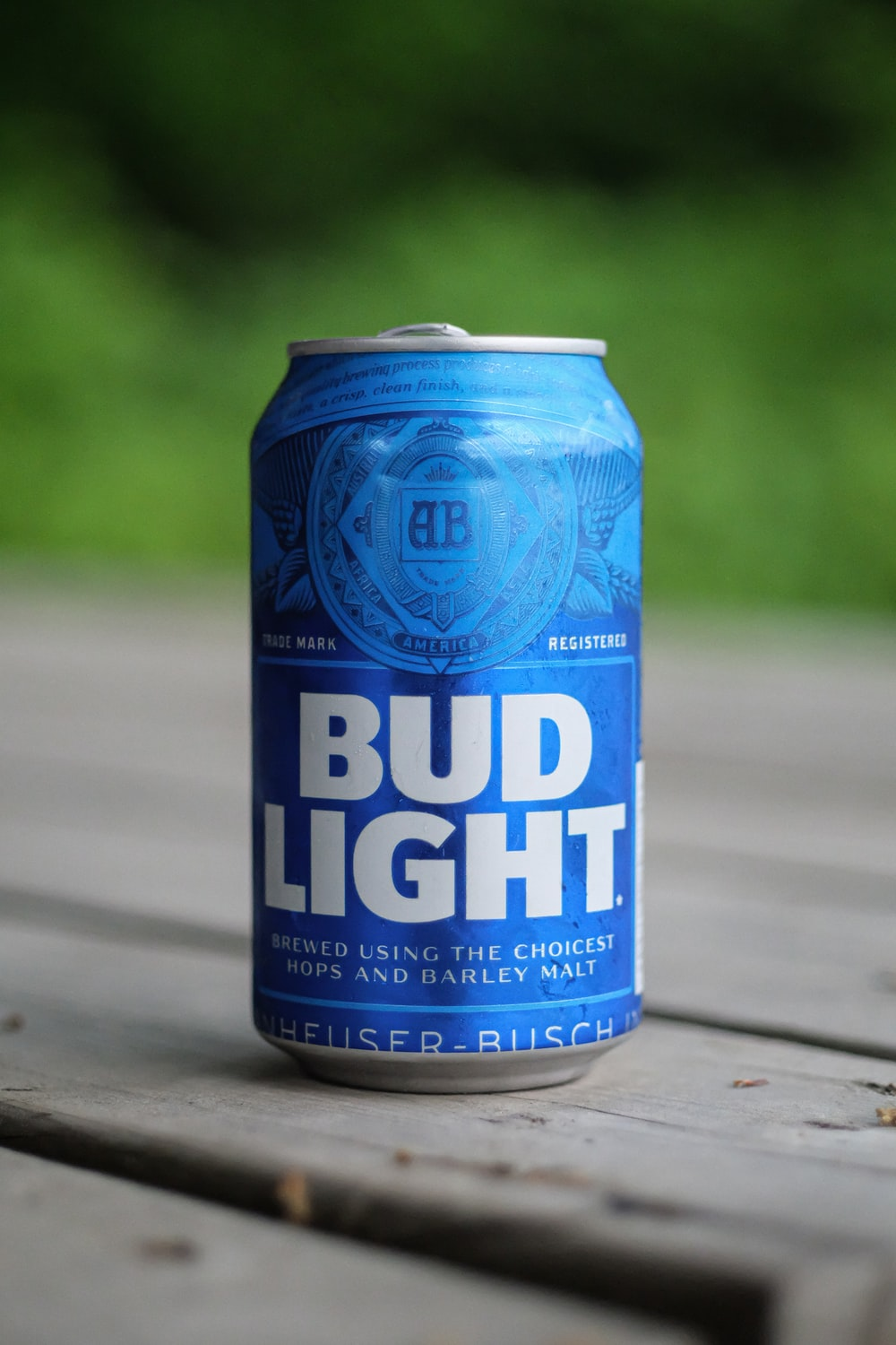 blue bud light can on gray wooden table