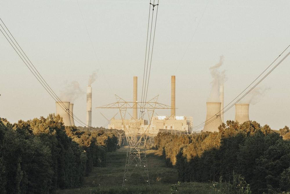 white factory under white sky during daytime