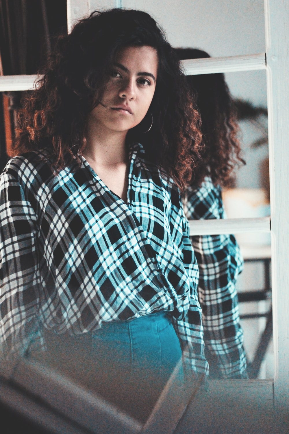 woman in black and white plaid dress shirt