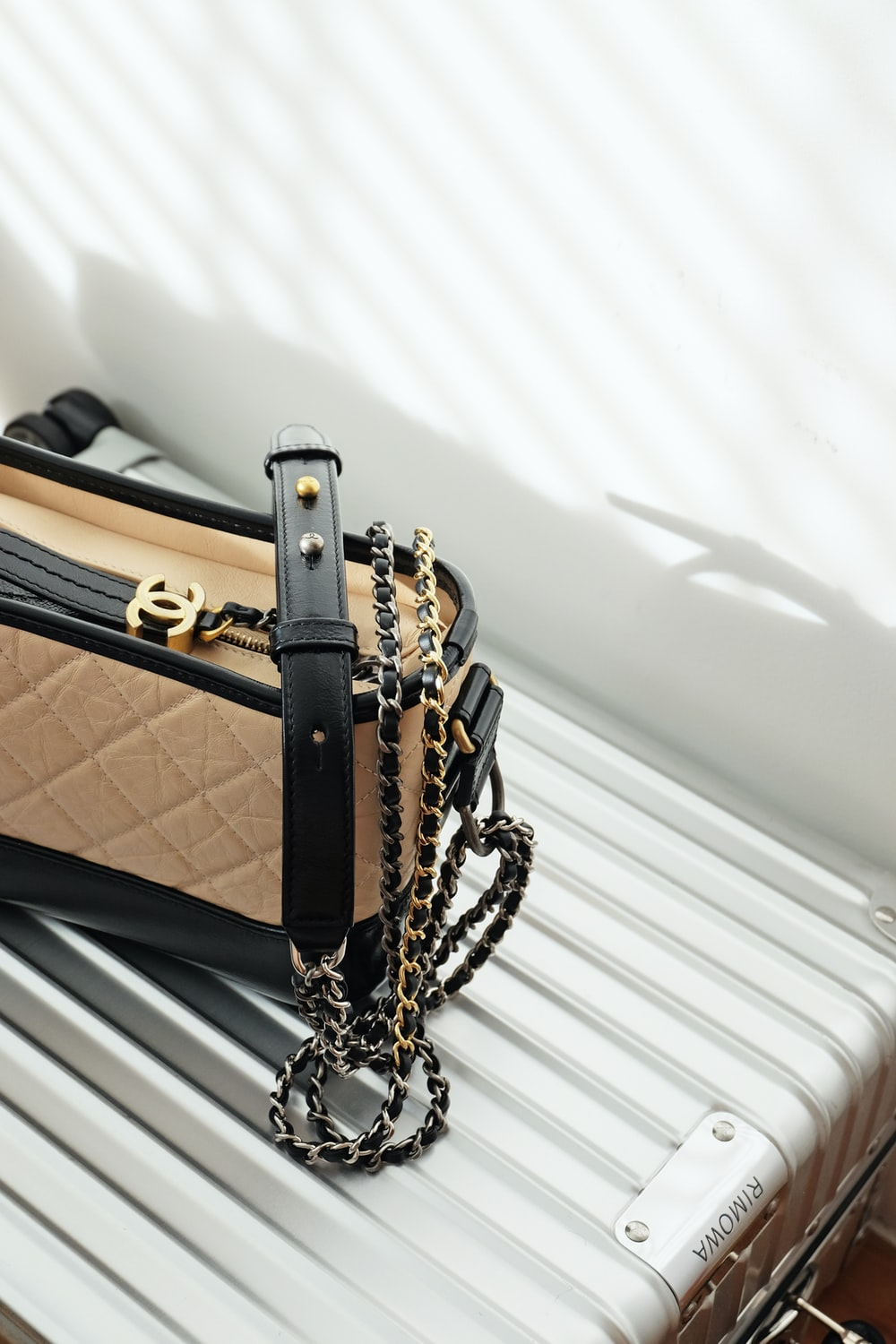 brown and black leather sling bag