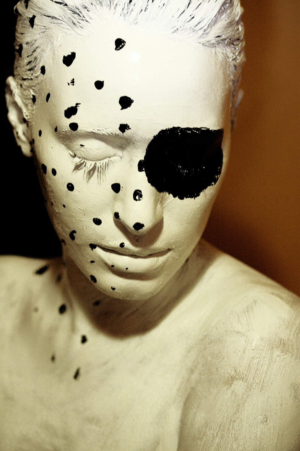 white and black face mask