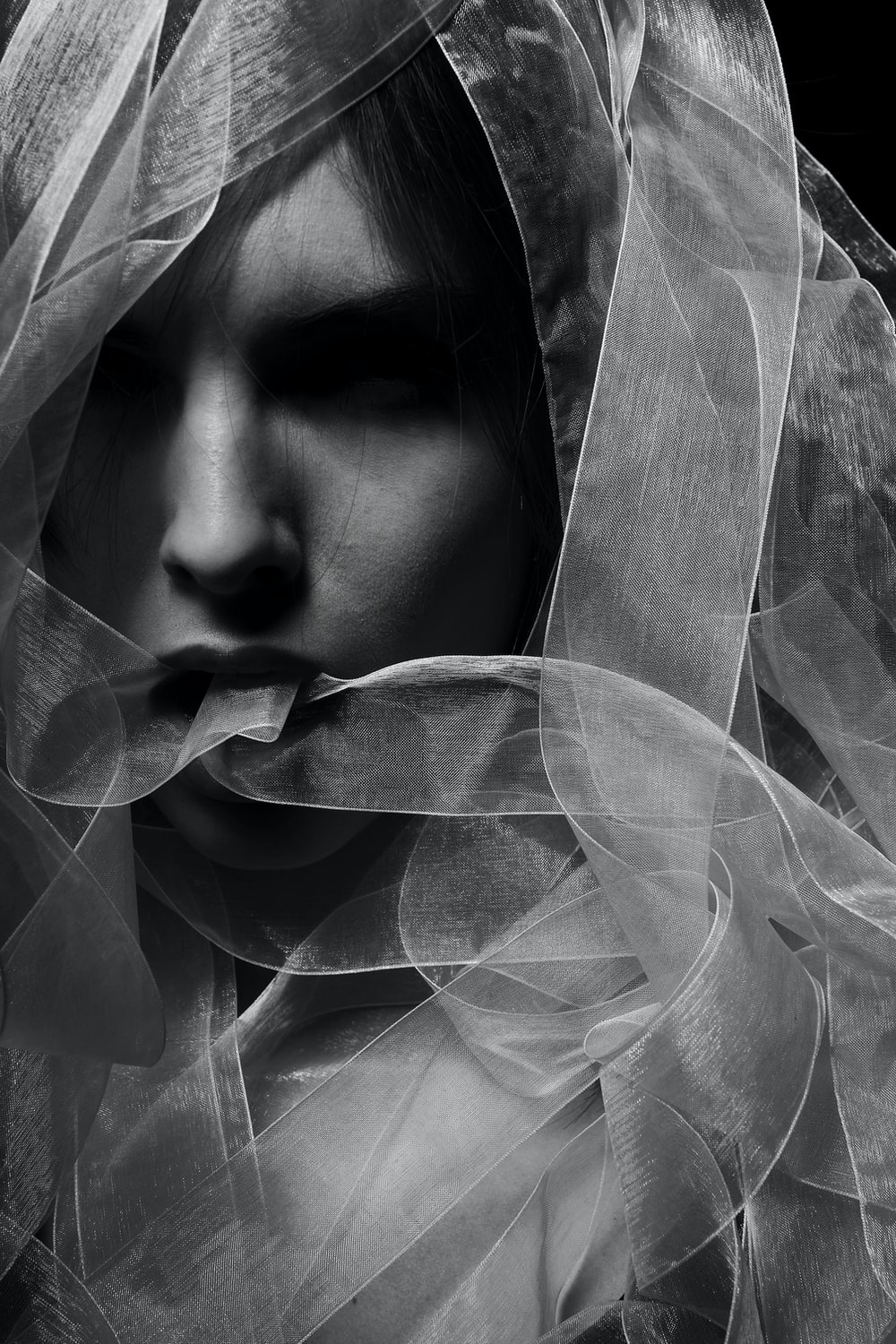 woman in white veil in grayscale