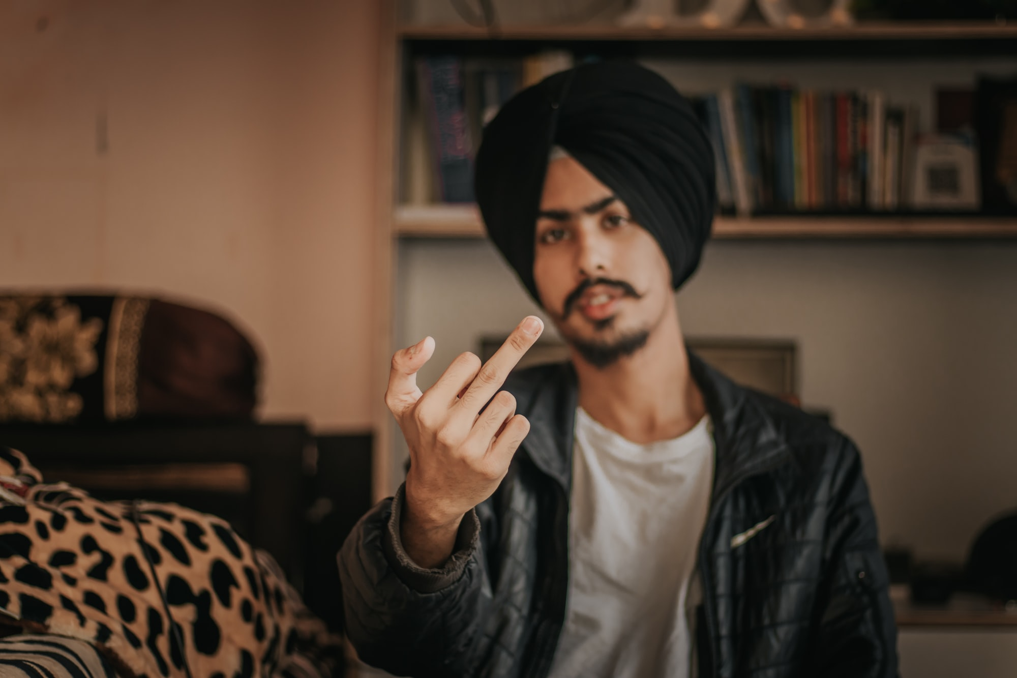 Boy showing middle finger to Haters