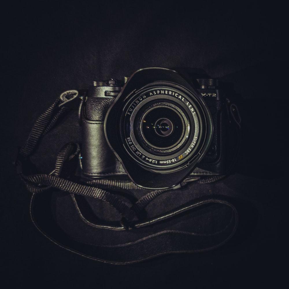 black nikon dslr camera on black bag