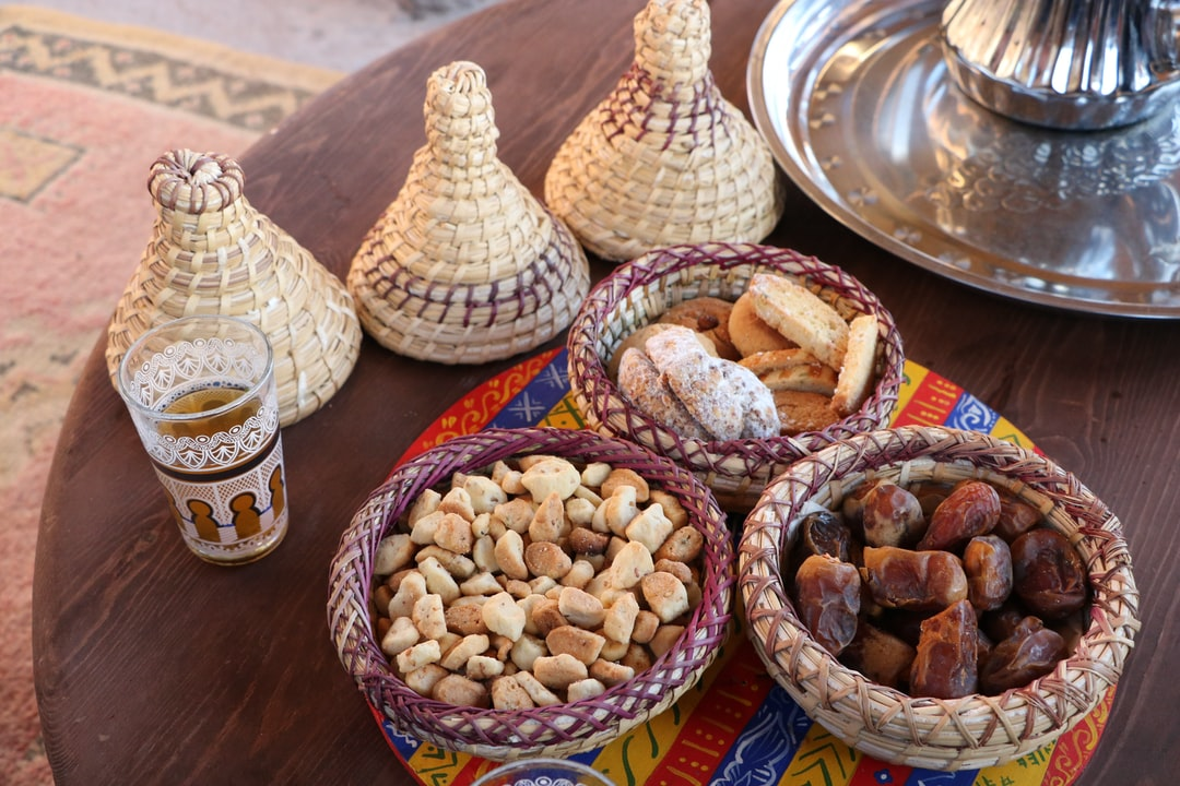 teatime in Morocco: woven wicker basket and delicacies around a mint tea