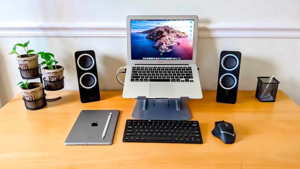 black computer keyboard beside black computer mouse