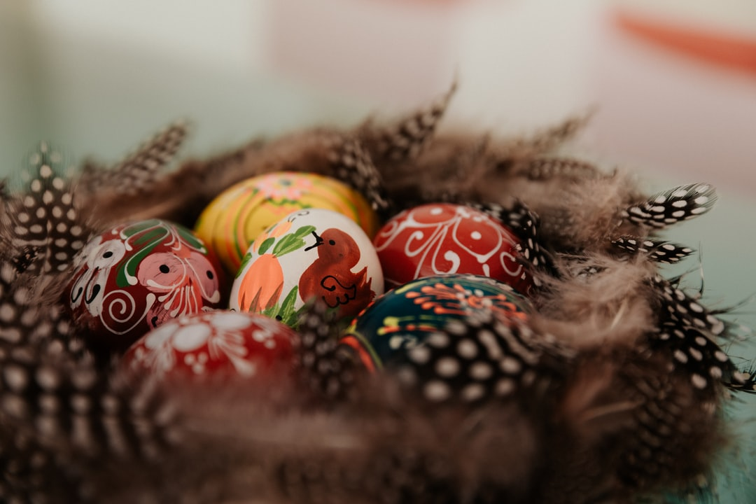Red and Green Baubles On Brown Nest - unsplash