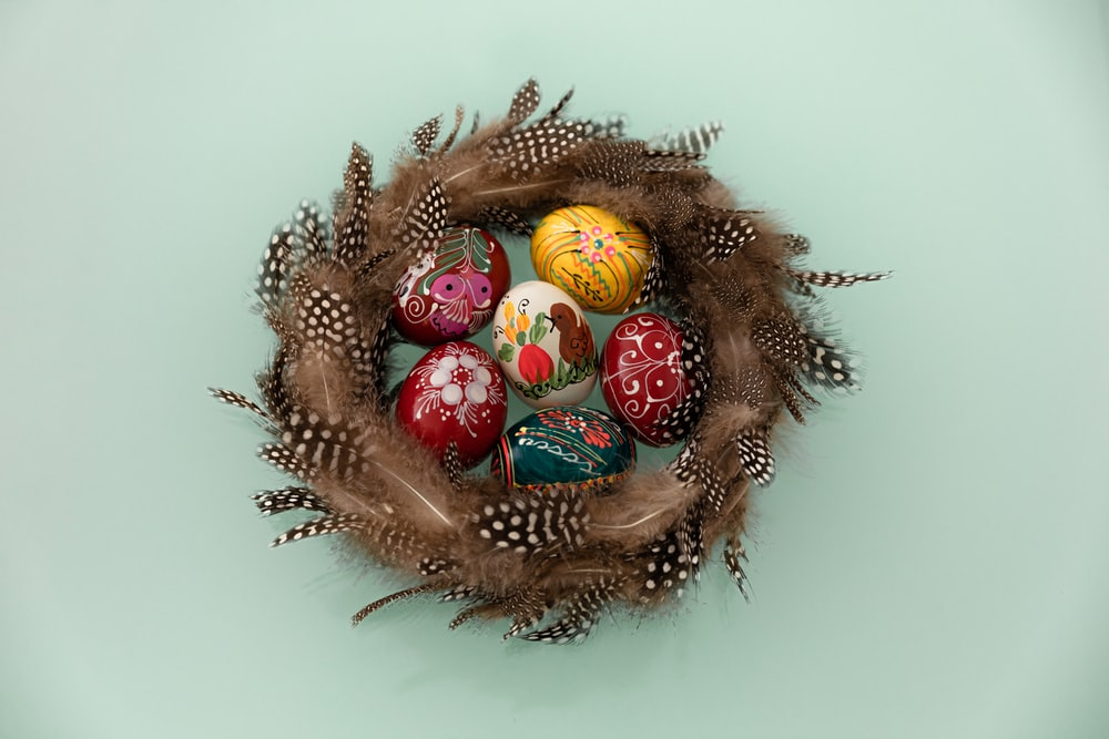 red and gold baubles on brown round wreath