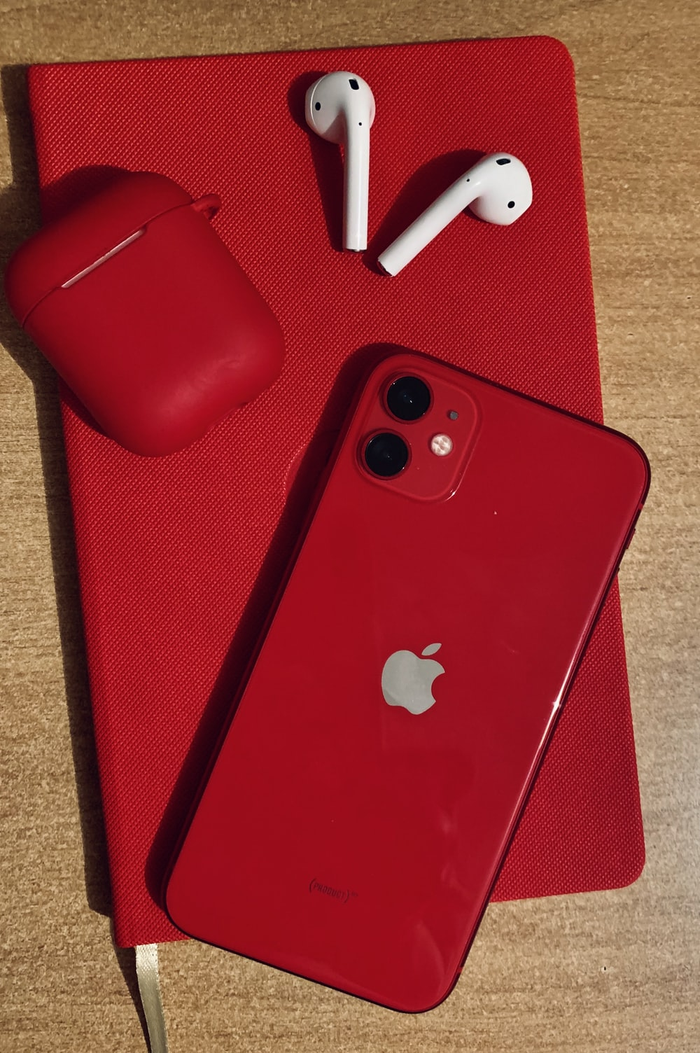 red iphone 7 plus on red textile