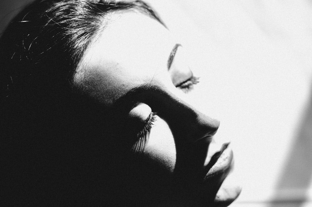 grayscale photo of womans face