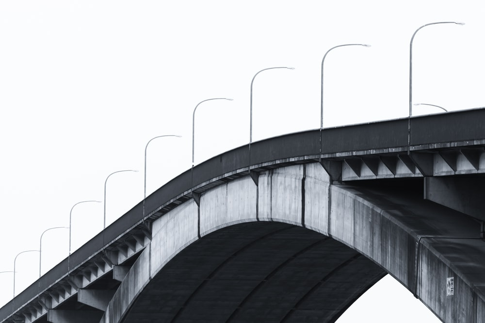 gray concrete bridge under white sky during daytime