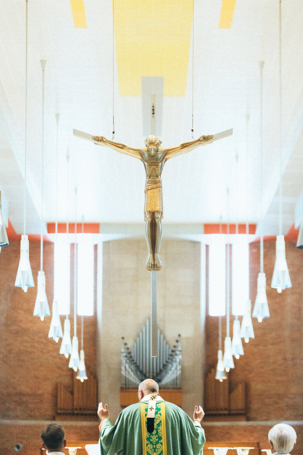 brown wooden crucifix on white wall