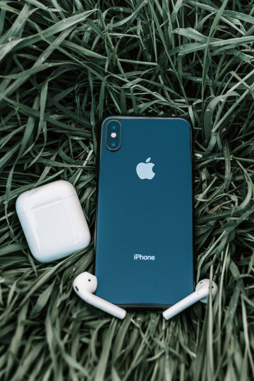 blue iphone 5 c on green grass