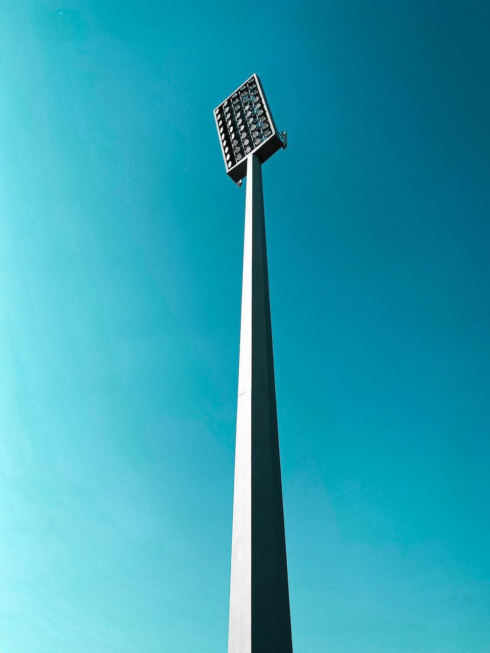 white and black street light under blue sky during daytime